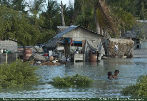 """Photo by <a href=""""http://www.worldviewofglobalwarming.org/pages/kiribati_2011.html"""">Gary Braasch</a>. Used with permission."""